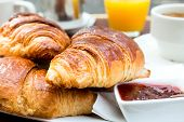pic of croissant  - Breakfast with coffee and croissants on table - JPG