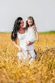 Mother And Daughter Among Wheat Ears