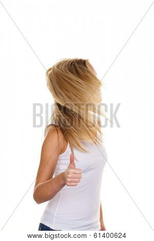 a young, successful woman holds his thumb up. symbol for success, exempted white background