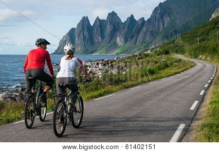 Two Cyclists Relax Biking