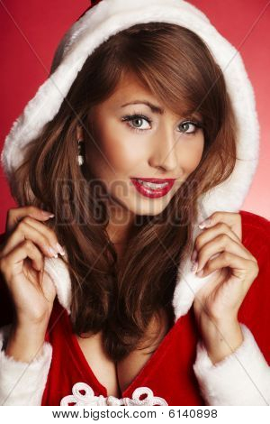 Attractive Woman Holding Red Hood On Red  Background.