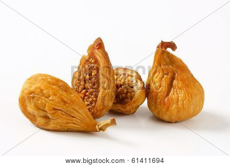 four pieces of dried and halved figs