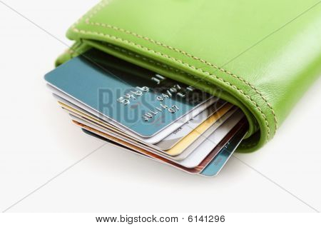 Green Wallet Stuffed With Credit Cards
