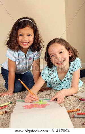 Cute little sisters coloring together