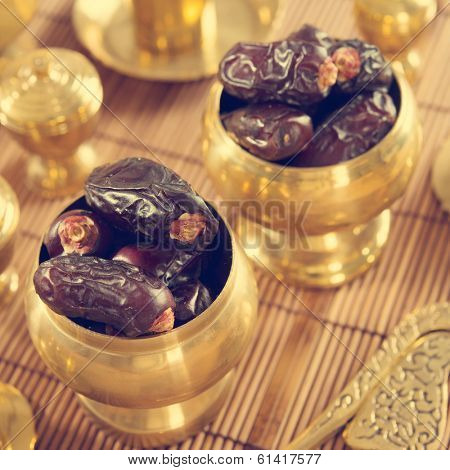Dried date palm fruits or kurma, ramadan food which eaten in fasting month in retro effect.