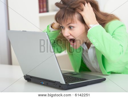 Young Girl Shouts Looking In Laptop Screen