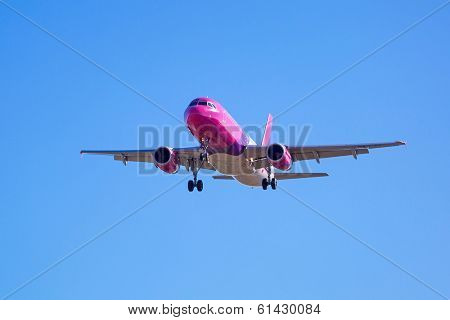 GDANSK AIRPORT, POLAND - 13 MAR: Wizz air plane landing on Lech Walesa Airport in Gdansk on March 13, 2014. Wizz air is a low-cost airline with largest fleet in Hungary who serves over 30 countries.