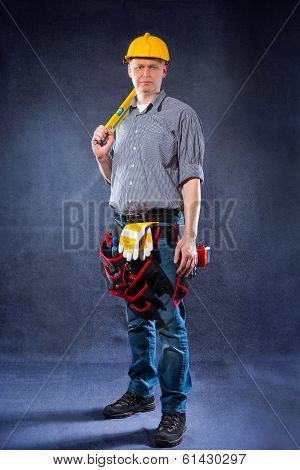 Construction worker holding a spirit level