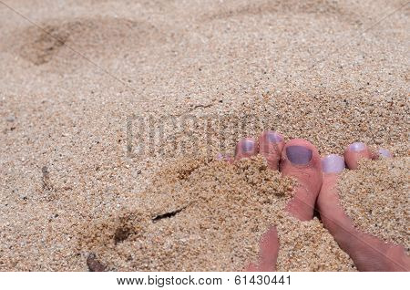 Fingers with pedicure the beach