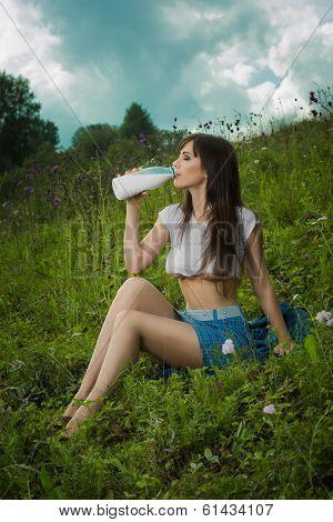 girl in a t-shirt drinking milk.