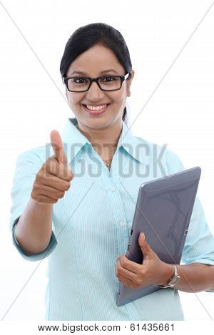 Businesswoman With Tablet And Making Thumbs Up Gesture