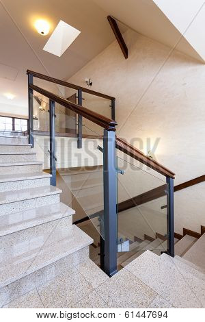 Staircase With Stone Steps And Glass Banister