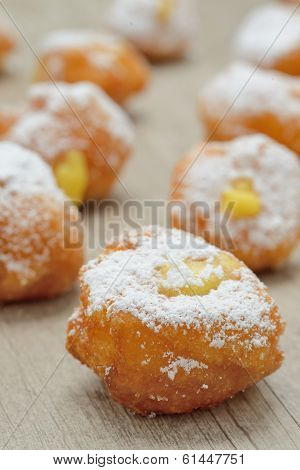 Pancakes stuffed fried home-made with custard and covered with powdered sugar