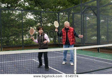 Man And Woman Playing Paddle Platform Tennis