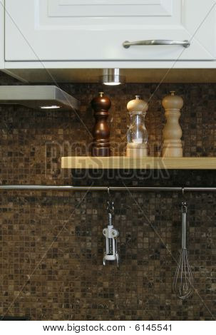 Close Up To A Kitchen Wall With Utensils On It