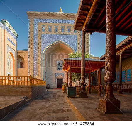 Yard of an ancient mosque in the city of Itchan Kala at sunny day, Khiva, Uzbekistan