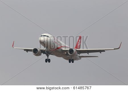 Air Arabia Airbus A320-214 aircraft, 6000th A320 in Airbus family on the blue sky background