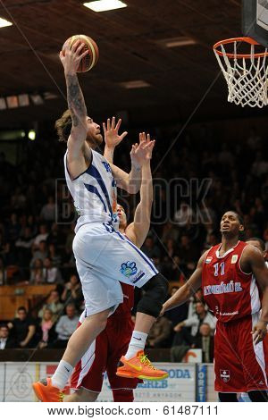KAPOSVAR, HUNGARY - MARCH 8: Roland Hendlein (white 11) in action at a Hungarian Championship basketball game with Kaposvar (white) vs. Paks (red) on March 8, 2014 in Kaposvar, Hungary.