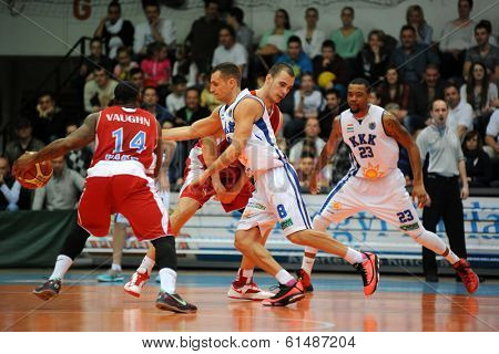 KAPOSVAR, HUNGARY - MARCH 8: Marton Fodor (white 8) in action at a Hungarian Championship basketball game with Kaposvar (white) vs. Paks (red) on March 8, 2014 in Kaposvar, Hungary.