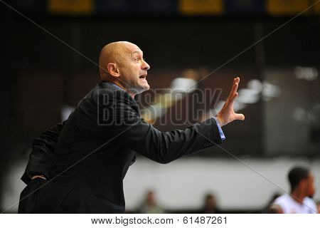 KAPOSVAR, HUNGARY - MARCH 8: Branislav Dzunic (Paks trainer) in action at a Hungarian Championship basketball game with Kaposvar (white) vs. Paks (red) on March 8, 2014 in Kaposvar, Hungary.