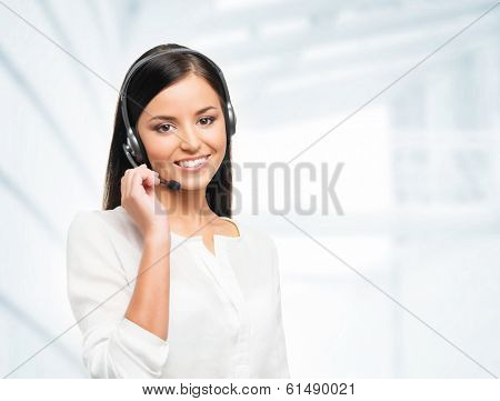 Young, confident and smiling customer support operator working in office