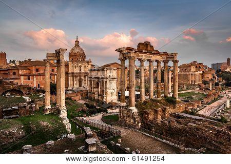 Roman Forum (foro Romano) And Ruins Of Septimius Severus Arch And Saturn Temple At Sunset, Rome, Ita