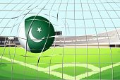 Illustration of a ball hitting a goal with the Pakistan flag