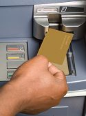 picture of automatic teller machine  - South African or African American drawing cash money with bank ATM card in auto teller machine - JPG