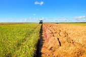 stock photo of plow  - Agricultural machinery on plowing of grounds under crops - JPG