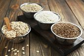 stock photo of oats  - Buckwheat oats barley and rice in a metal bowl on the table - JPG