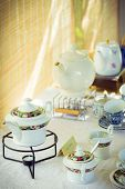 Vintage retro tea set with bamboo background