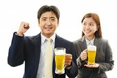 Businessman and Business woman enjoy beer