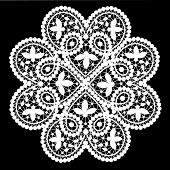 stock photo of doilies  - White lace doily with flowery pattern on a black background - JPG