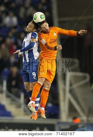 BARCELONA - JAN, 21: Sergio Garcia(L) of Espanyol vies with Sergio Ramos(R) of Real Madrid during the Spanish Kings Cup match at the Estadi Cornella on January 21, 2014 in Barcelona, Spain