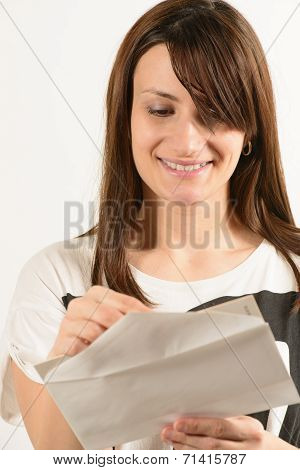 Young woman looking in an envelope