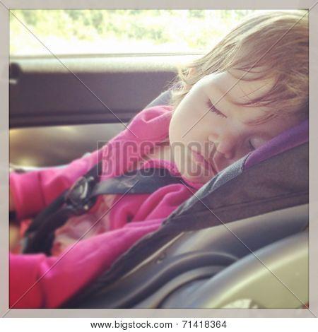 Sweet baby girl sleeping in car seat - instagram effect