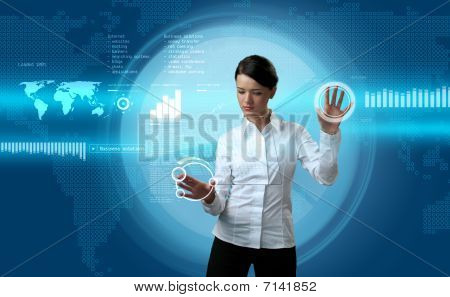Attractive Brunette Navigating Futuristic Interface