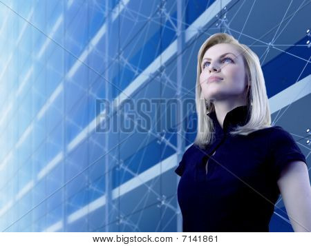 Attractive Blonde Standing By The Skyscraper