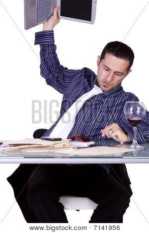 Upset Businessman At His Desk In Suit