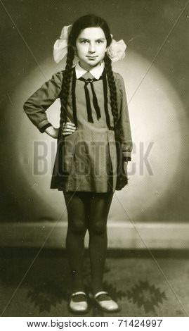 ILOWA, POLAND, MAY 11, 1966: Vintage photo of little girl with long braids