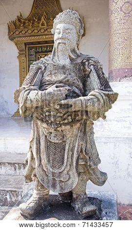 Stone Guardian At Buddist Temple In Luang Prabang