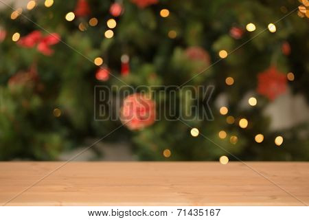 Desk with christmas tree in background at home in the living room