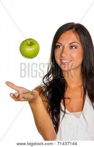 a young woman holding an apple in his hand. fruits and vegetables for healthy and vitamin rich diet