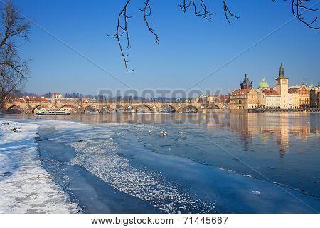 Snowy Prague With Frozen River Vltava