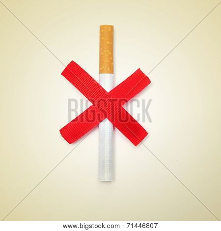 a cigarette and two crossed red slashes, depicting the concept of no smoking, on a beige background, with a retro effect