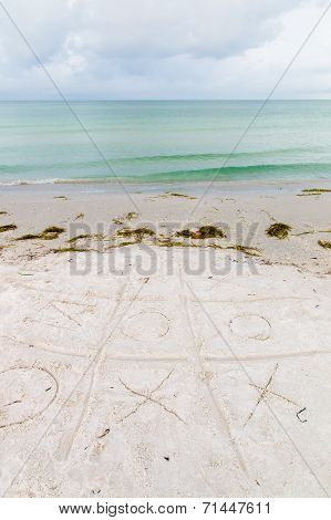 Noughts-and-crosses Game On A  Beach