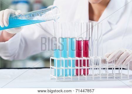 Woman Using Test Tubes In Laboratory
