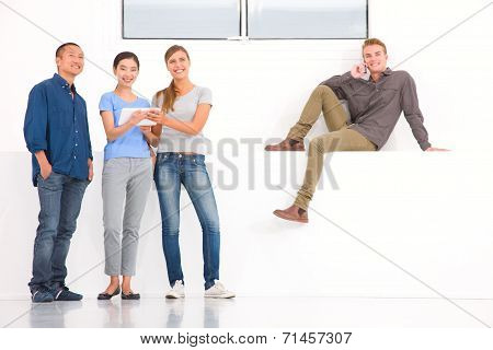 Group Of Multi Ethnic Friends Using Digital Tablet And Cell Phone