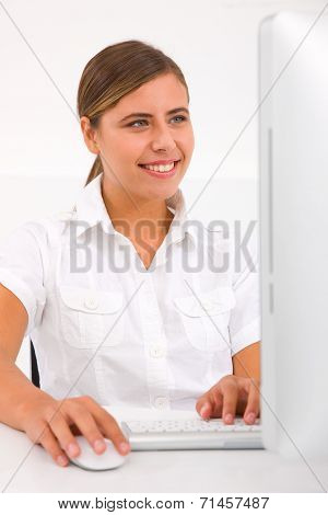 Portrait Of Happy Young Woman Using Computer
