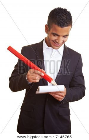 Manager Writing With Red Pencil